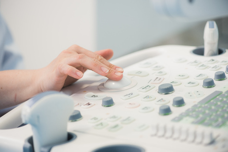 young woman doctors hands close up preparing for an ultrasound device scan. Stockfoto