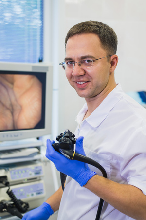 proctologist doctor holding Ligador hemorroidal in office Stock Photo