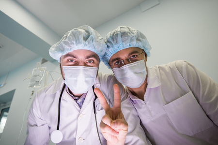 Two happy surgeon team. Below view