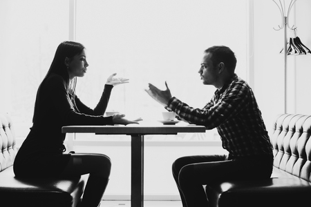 breaking: Man and woman in discussions in the restaurant