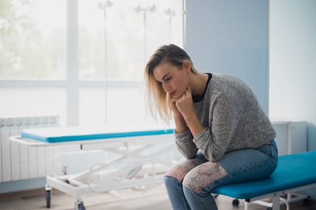Full length portrait of a woman waiting for medical examination Stock Photo
