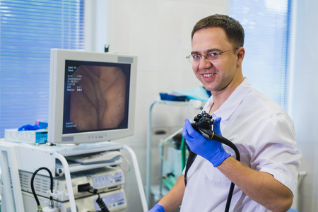 proctologist doctor holding Ligador hemorroidal in office Stock Photo