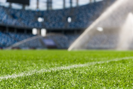 Irrigation turf. Sprinkler watering football field.