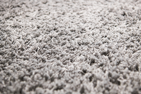 White carpet background texture, close up, gray textile texture, fluffy rug background, Wool fabric texture, beige hairy carpet, fragment shaggy mat, interior, material with pattern abstract. Banco de Imagens