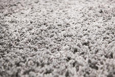 Witte tapijt achtergrondstructuur, close-up, grijze textiel textuur, pluizige deken achtergrond, wollen stof textuur, beige harig tapijt, fragment ruige mat, interieur, materiaal met patroon abstract. Stockfoto