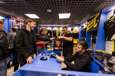 MOSCOW, RUSSIA - OCTOBER 27 2018: EPICENTER Counter Strike: Global Offensive esports event. Brand eSport merchandise and apparel shop: T-Shirts, hoodies of Natus Vincere NaVi team. Editoriali
