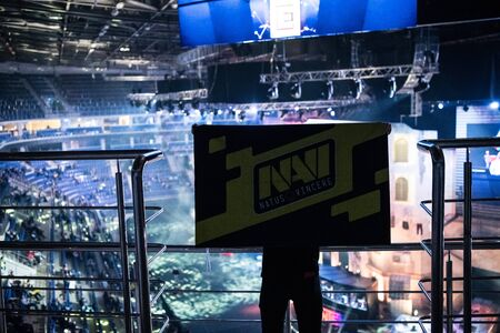 MOSCOW, RUSSIA - OCTOBER 27 2018: EPICENTER Counter Strike: Global Offensive esports event. Fan on a tribune at tournaments arena with team Natus Vincere flag.