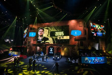 MOSCOW, RUSSIA - OCTOBER 27 2018: EPICENTER Counter Strike: Global Offensive esports event. Player Danylo Zeus Teslenko on stage and on a main screen. Introduction of a team NaVi Natus Vincere before the match.