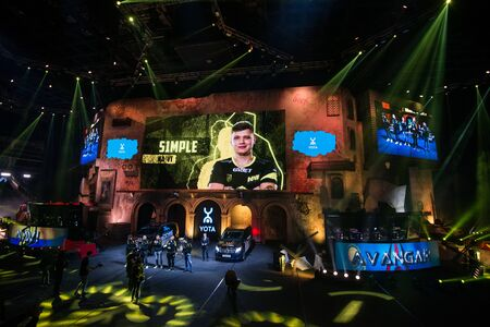 MOSCOW, RUSSIA - OCTOBER 27 2018: EPICENTER Counter Strike: Global Offensive esports event. Player Oleksandr s1mple Kostyliev on stage and on a main screen. Introduction of a team NaVi Natus Vincere before the match. Editoriali