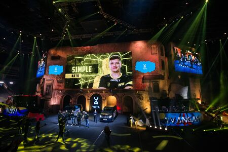 MOSCOW, RUSSIA - OCTOBER 27 2018: EPICENTER Counter Strike: Global Offensive esports event. Player Oleksandr s1mple Kostyliev on stage and on a main screen. Introduction of a team NaVi Natus Vincere before the match.
