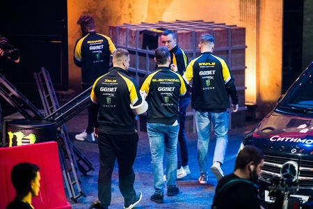 MOSCOW, RUSSIA - OCTOBER 27 2018: EPICENTER Counter Strike: Global Offensive esports event. Introduction of a team NaVi Natus Vincere. Players going to gaming booth. Editoriali