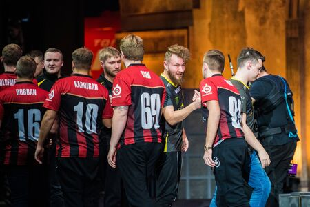 MOSCOW, RUSSIA - OCTOBER 27 2018: EPICENTER Counter Strike: Global Offensive esports event. Team Faze Clan players shake hands with their opponents team NaVi after their victory at final match. Editorial