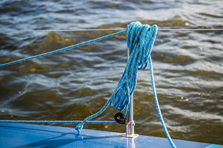 The rigging block with swivel and yellow rope. Part of the rigging of the yacht Reklamní fotografie