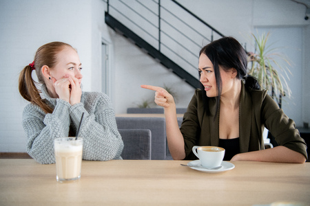 Two girls claiming in quarrel at caffeteria