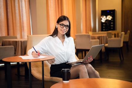 Young businesswoman on a coffee break. Using tablet computer. Reklamní fotografie