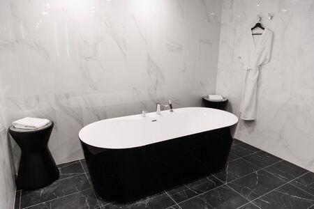 Dark luxury bathroom interior with modern furniture