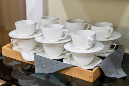 Group of empty cups, in many rows of white cup for service tea or coffee in breakfast or buffet and seminar event.