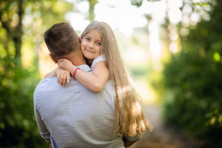 Happy daughter with her father in the park