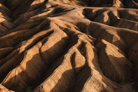Sci-Fi Mars looking Rocky landscape background at Zabriskie Point, Death Valley NP, California. Фото со стока
