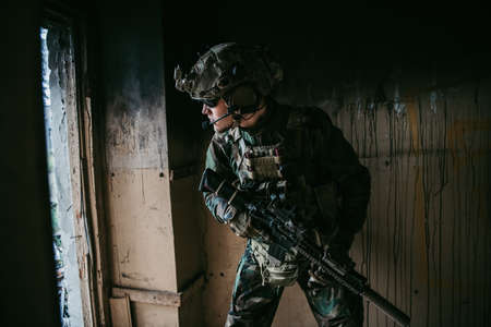 Soldier in combat. Urban combat training, soldier entering abandoned building. Anti terrorist operation battlefield training.