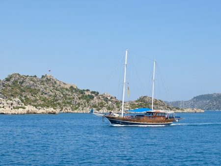A boat sailing on the blue sea photo