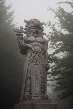 The statue of the pagan god of Slavs Radegast on mountain Radhost - the god of the sun, abundance and harvest. Majestic sculpture in haze.