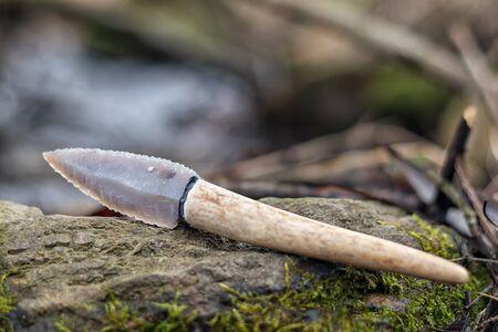 Flint knife - stone age tool (leaf blade in deer antler) in nature