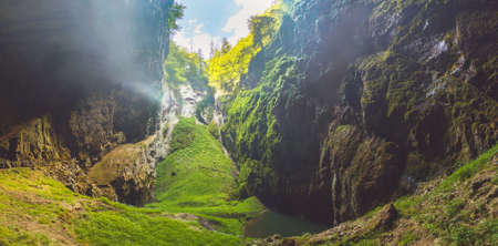 Macocha Gorge - The Macocha Abyss. Sinkhole in the Moravian Karst Punkva caves system of the Czech Republic. View from the bottom of the abyss.