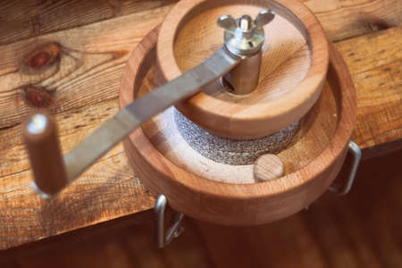 grain grinder - Manual Grain Mill for Hand Grinding, on a wooden table Stockfoto