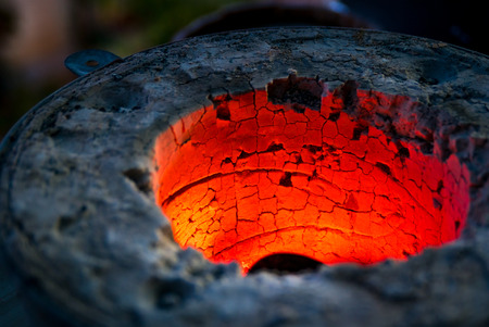 A closeup picture of a red hot oven for melting metals