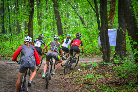 Lviv, Ukraine - August 17, 2016: Group of young women MTB cyclists competing in the forest near Lviv in Ukraine at 4th round of amateur xc cup of Ukraine 2016. Editorial