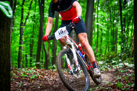 Lviv, Ukraine - August 17, 2016: MTB cyclist I. Bozhkov competing in the forest near Lviv in Ukraine at 4th round of amateur xc cup of Ukraine 2016. Editorial