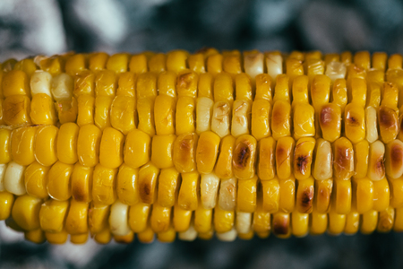 Fresh golden yellow corn closeup on the outdoor barbecue