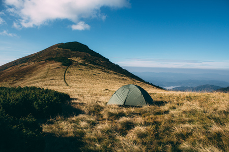 Tent high in mountains. Carpathian. Top on background