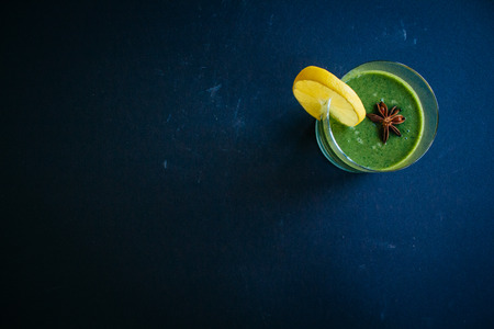 Raw smoothie green color with celery, cucumber and spinach. Top view