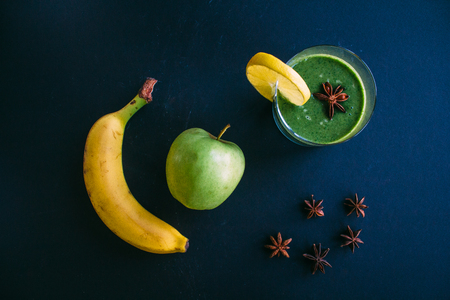 Still life, raw smoothie green, apple, banana and anise. Top view