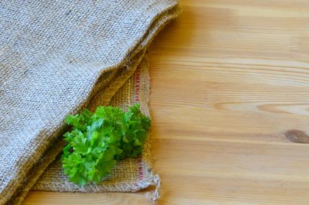 jute sack: The corner of  jute sack  on wooden background