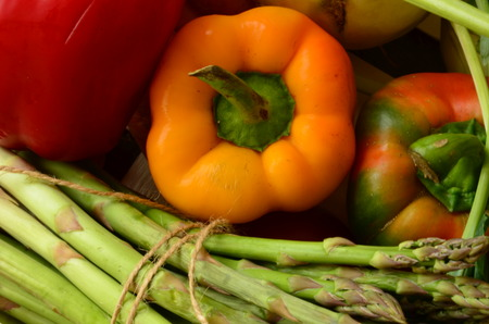 Peppers, asparagus and kohlrabies in wooden box photo