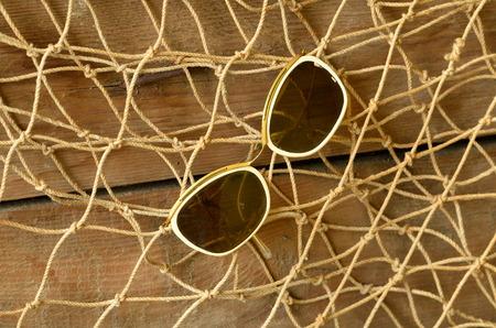 trawl: Vintage sunglasses and beam trawl. Vintage summer.
