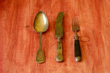 vintage cutlery: Vintage cutlery on brown wooden background