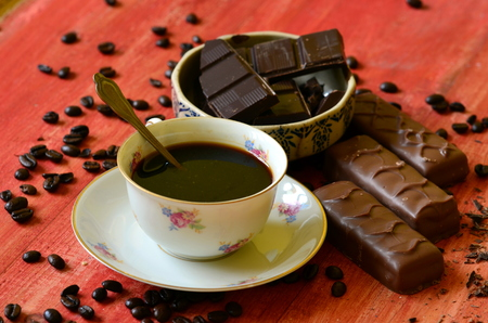 spall: Different chocolate bars and coffee beans and peels of chocolate