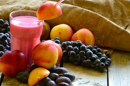 Fresh fruit smoothie on white background