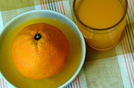 retreat: Retreat with orange juice and porcelain juicer on dish towel
