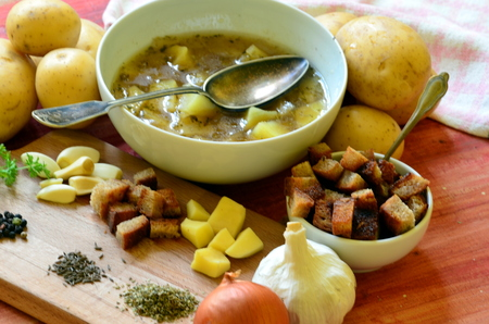 Garlic soup with vintage spoon and ingredients