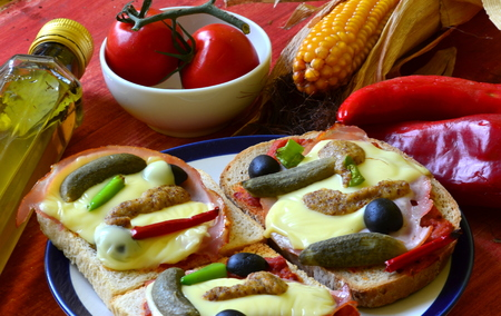 gherkins: Baked bread with ham, cheese, mustard, gherkins and olives