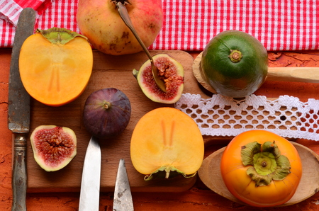 chopping board: Chopped fig and persimmon on chopping board