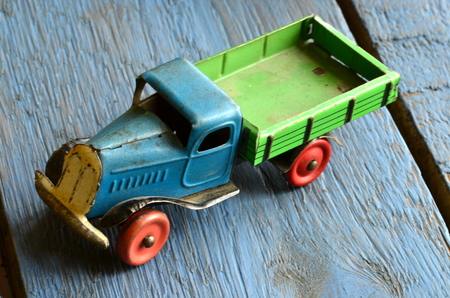 antique fire truck: Vintage truck (lorry) toy on blue wooden background. Stock Photo