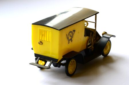 modell: Isolated vintage post car car toy on white background