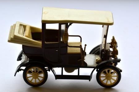Isolated vintage car toy on white background Standard-Bild