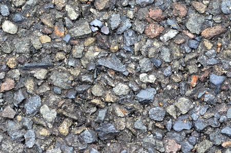 rough road: Rough asphalt texture - abstract road background. Closeup